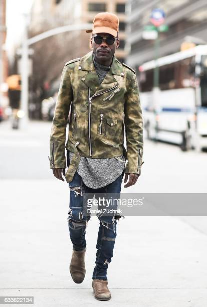 Keino Benjamin is seen wearing a Violent Rose hat camo jacket and blue jeans outside of the General Idea show during New York Fashion Week Men's AW17...