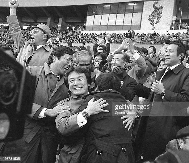 Keio University head coach Akio Ueda celebrates with team staffs after winning the All Japan Rugby Championship final match between Keio University...