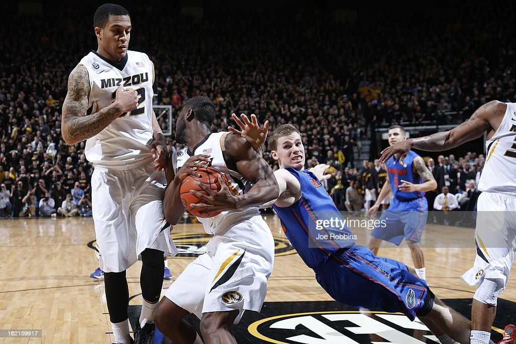 Keion Bell #5 and Jabari Brown #32 of the Missouri Tigers defend against Erik Murphy #33 of the Florida Gators during the game at Mizzou Arena on February 19, 2013 in Columbia, Missouri. Missouri upset Florida 63-60.