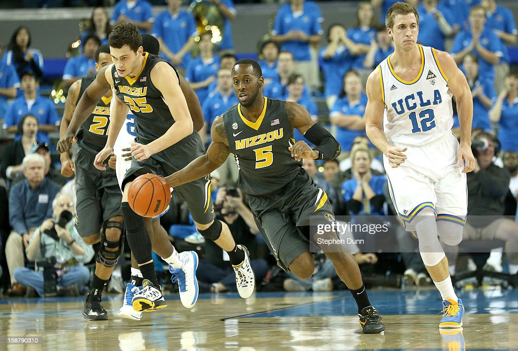 Keion Bell #5 of the Missouri Tigers starts a break against the UCLA Bruins at Pauley Pavilion on December 28, 2012 in Los Angeles, California.
