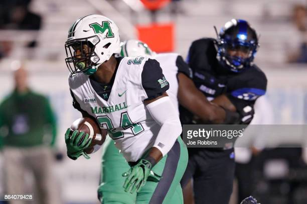 Keion Davis of the Marshall Thundering Herd runs for a nineyard touchdown in the second quarter of a game against the Middle Tennessee Blue Raiders...