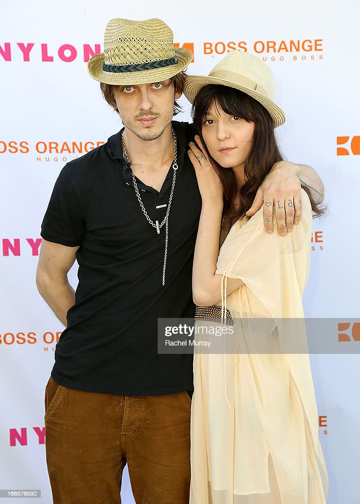 Keir Knight (L) and <a gi-track='captionPersonalityLinkClicked' href=/galleries/search?phrase=Irina+Lazareanu&family=editorial&specificpeople=3806030 ng-click='$event.stopPropagation()'>Irina Lazareanu</a> attend NYLON x BOSS ORANGE Escape House - Day 1 at Lake La Quinta Inn on April 13, 2013 in La Quinta, California.