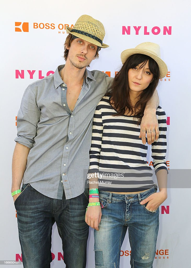 Keir Knight (L) and model Irina Lazareanu in Hugo Boss attend NYLON x BOSS ORANGE Escape House - Day 2 at Lake La Quinta Inn on April 14, 2013 in La Quinta, California.