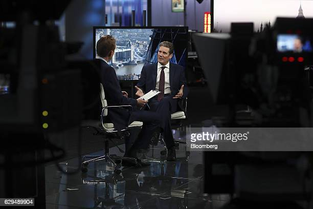 Keir Starmer shadow secretary of state for the UK's opposition Labour Party right gestures as he speaks during a Bloomberg Television interview in...