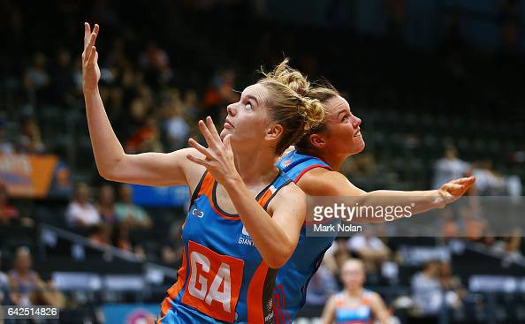 Keira Austin of Canberra and Emma Tickner of NSW contest possession during round one of the ANL match between Canberra Giants and Netball NSW...