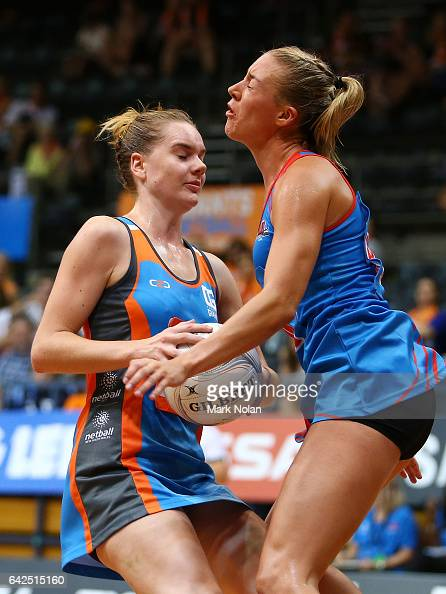 Keira Austin of Canberra collides with a NSW player during round one of the ANL match between Canberra Giants and Netball NSW Waratahs at Sydney...