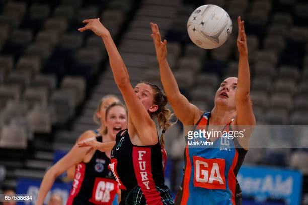 Keira Austin of Canberra Giants and Kate Eddy of Victorian Fury go for the ball for the ball during the round six ANL match between the Vic Fury and...