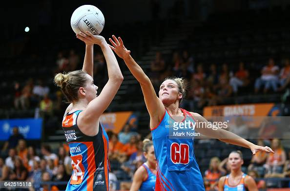 Keira Austin of Canberra shoots for goal as Emma Tickner of NSW defends during round one of the ANL match between Canberra Giants and Netball NSW...