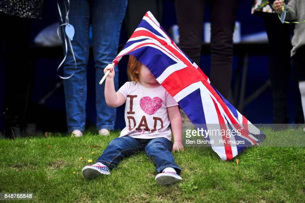 Keira Hill aged two plays with a Union Flag as she waits for her dad Sergeant Craig Hill and other soldiers from 19th Regiment Royal Artillery to be...