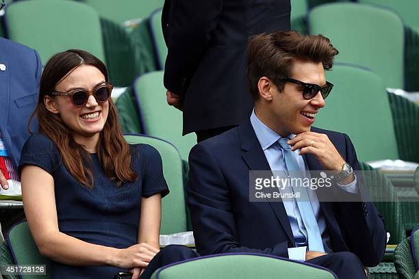 Keira Knightley and James Righton sit in the Royal Box on Centre Court before the Ladies' Singles final match between Eugenie Bouchard of Canada and...
