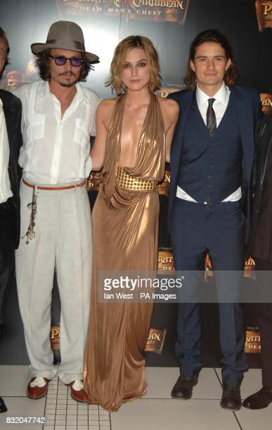Keira Knightley with Orlando Bloom and Johnny Depp arriving for the European Premiere of Pirates of the Caribbean Dead Man's Chest at the Odeon...