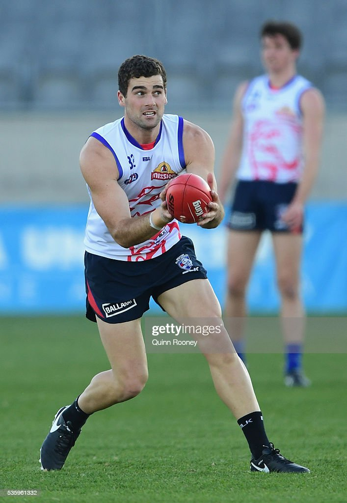 Keiran Collins of the Bulldogs marks during a Western Bulldogs AFL training session at Whitten Oval on May 31, 2016 in Melbourne, Australia.