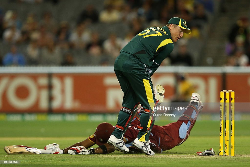Keiron Pollard of the West Indies dives to avoid a run out by Brad Haddin of Australia during game five of the Commonwealth Bank International Series between Australia and the West Indies at Melbourne Cricket Ground on February 10, 2013 in Melbourne, Australia.