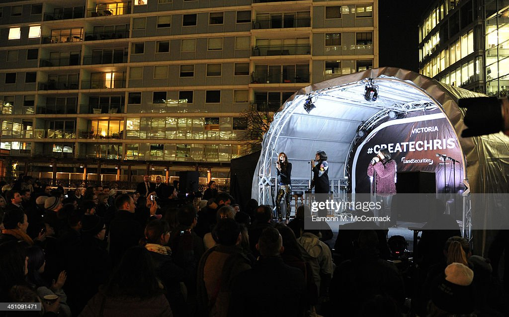Keisha Buchanan, Mutya Buena and Siobhan Donaghy of the Original Sugababes Mutya Keisha Siobhan (MKS) officially switched on Victoria's lights and launch the 90ft outdoor #CreateChristmas photography exhibition at Cardinal Place on November 21, 2013 in London, England.