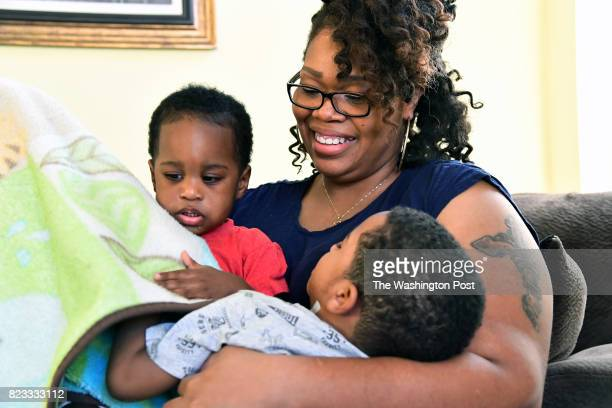 Keisha Carney balances sons Mekhi left and Malik on her lap as both were not feeling well May 26 2017 in Dumfries VA Keisha Carney had Essure...