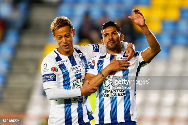 Keisuke Honda and Franco Jara of Pachuca celebrate their team's first goal during the quarter final match between Pachuca and Tijuana as part of the...