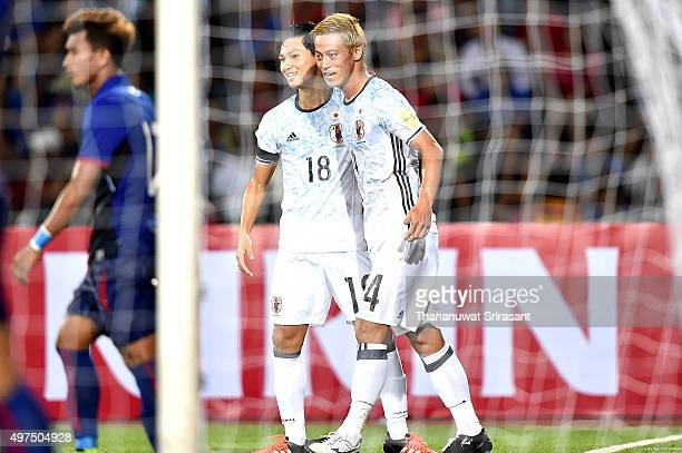 Keisuke Honda and his team mate Takumi Minamino of Japan celebrate during the 2018 FIFA World Cup Qualifier match between Cambodia and Japan on...