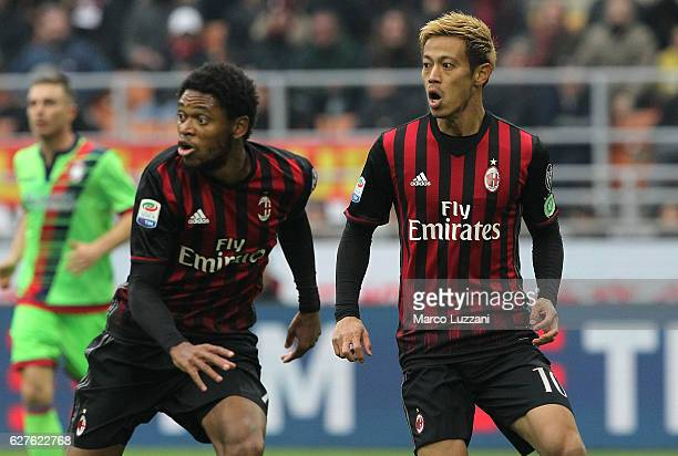 Keisuke Honda and Luiz Adriano of AC Milan look on during the Serie A match between AC Milan and FC Crotone at Stadio Giuseppe Meazza on December 4...