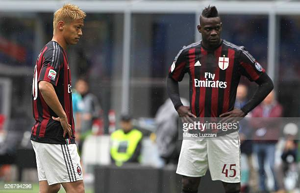 Keisuke Honda and Mario Balotelli of AC Milan look on during the Serie A match between AC Milan and Frosinone Calcio at Stadio Giuseppe Meazza on May...