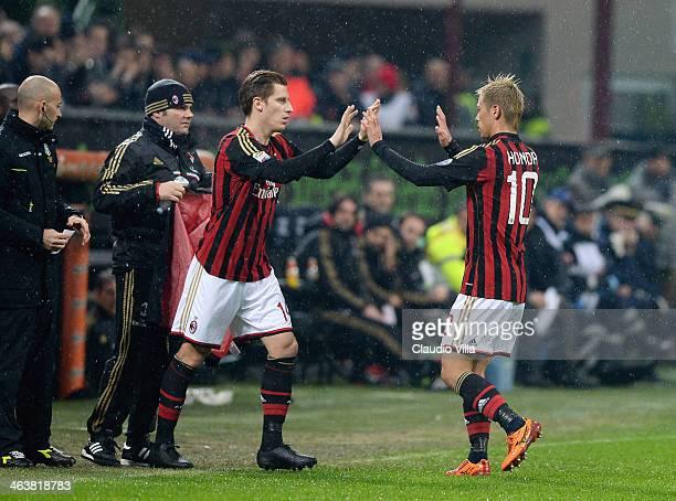 Keisuke Honda and Valter Birsa of AC Milan swaps places during the Serie A match between AC Milan and Hellas Verona FC at San Siro Stadium on January...