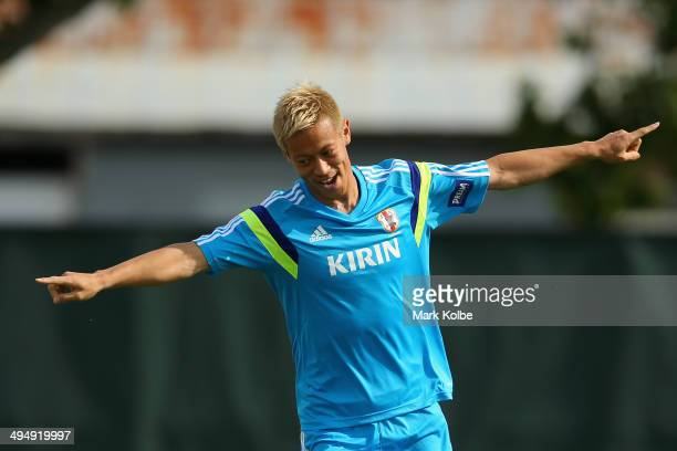 Keisuke Honda celebrates scoring a goal in a drill during a Japan training session at North Greenwood Recreation Aquatic Complex on May 31 2014 in...