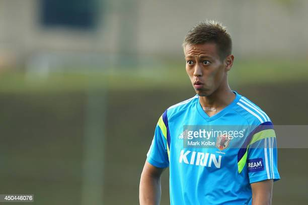 Keisuke Honda looks on during a Japan training session at the Japan national team base camp at the Spa Sport Resort on June 11 2014 in Itu Sao Paulo