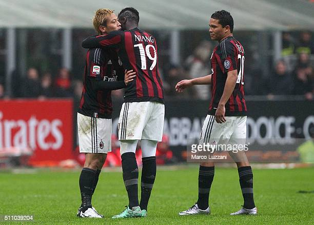 Keisuke Honda of AC Milan celebrates his goal with his teammates M Baye Niang and Carlos Bacca during the Serie A match between AC Milan and Genoa...