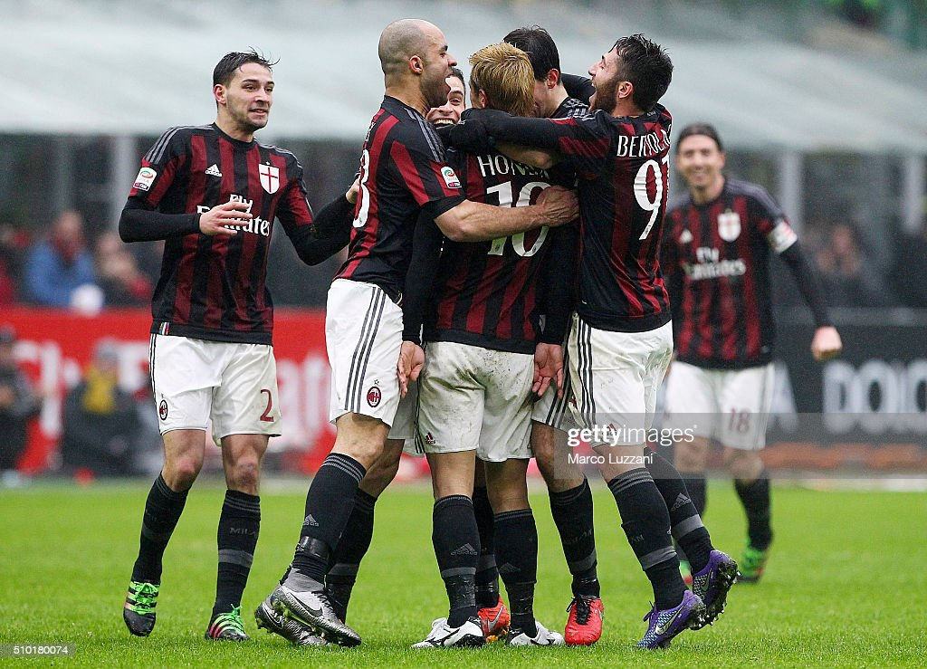 <a gi-track='captionPersonalityLinkClicked' href=/galleries/search?phrase=Keisuke+Honda&family=editorial&specificpeople=2333022 ng-click='$event.stopPropagation()'>Keisuke Honda</a> (C) of AC Milan celebrates his goal with his team-mates during the Serie A match between AC Milan and Genoa CFC at Stadio Giuseppe Meazza on February 14, 2016 in Milan, Italy.