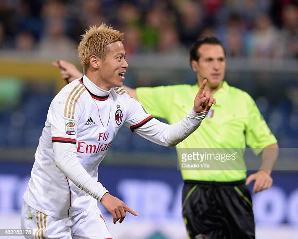 Keisuke Honda of AC Milan celebrates scoring the second goal during the Serie A match between Genoa CFC v AC Milan at Stadio Luigi Ferraris on April...