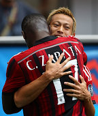 Keisuke Honda of AC Milan celebrates with his teammate Cristian Zapata after scoring the opening goal during the Serie A match between AC Milan and...
