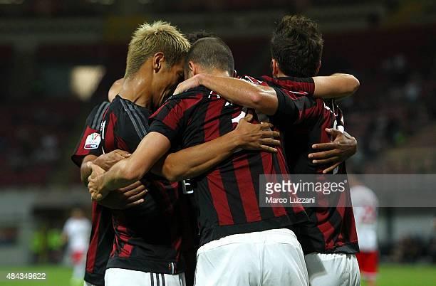 Keisuke Honda of AC Milan celebrates with his teammates after scoring the opening goal during the TIM Cup match between AC Milan and AC Perugia at...