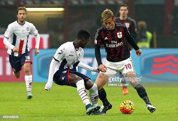 Keisuke Honda of AC Milan competes for the ball with Eloge Koffi Guy Yao of Eloge Koffi Guy Yao during the TIM Cup match between AC Milan and FC...