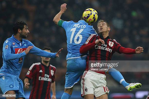 Keisuke Honda of AC Milan competes for the ball with Giandomenico Mesto and Raul Albiol of SSC Napoli during the Serie A match between AC Milan and...