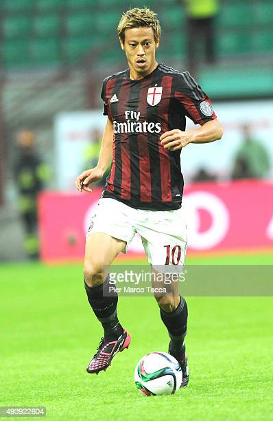 Keisuke Honda of AC Milan in action during the Berlusconi Trophy match between AC Milan and FC Internazionale at Stadio Giuseppe Meazza on October 21...