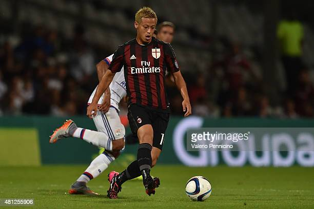 Keisuke Honda of AC Milan in action during the preseason friendly match between Olympique Lyonnais and AC MIlan at Gerland Stadium on July 18 2015 in...
