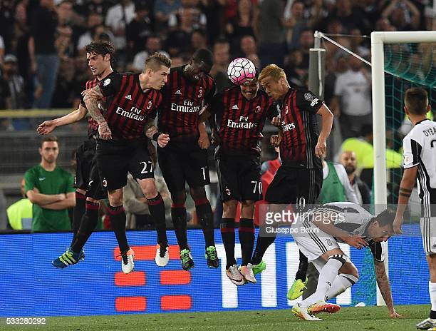 Keisuke Honda of AC Milan in action during the TIM Cup match between AC Milan and Juventus FC at Stadio Olimpico on May 21 2016 in Rome Italy