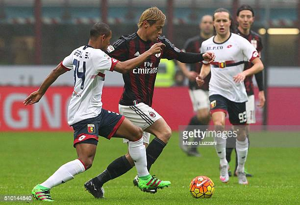 Keisuke Honda of AC Milan is challenged by Gabriel Silva of Genoa CFC during the Serie A match between AC Milan and Genoa CFC at Stadio Giuseppe...