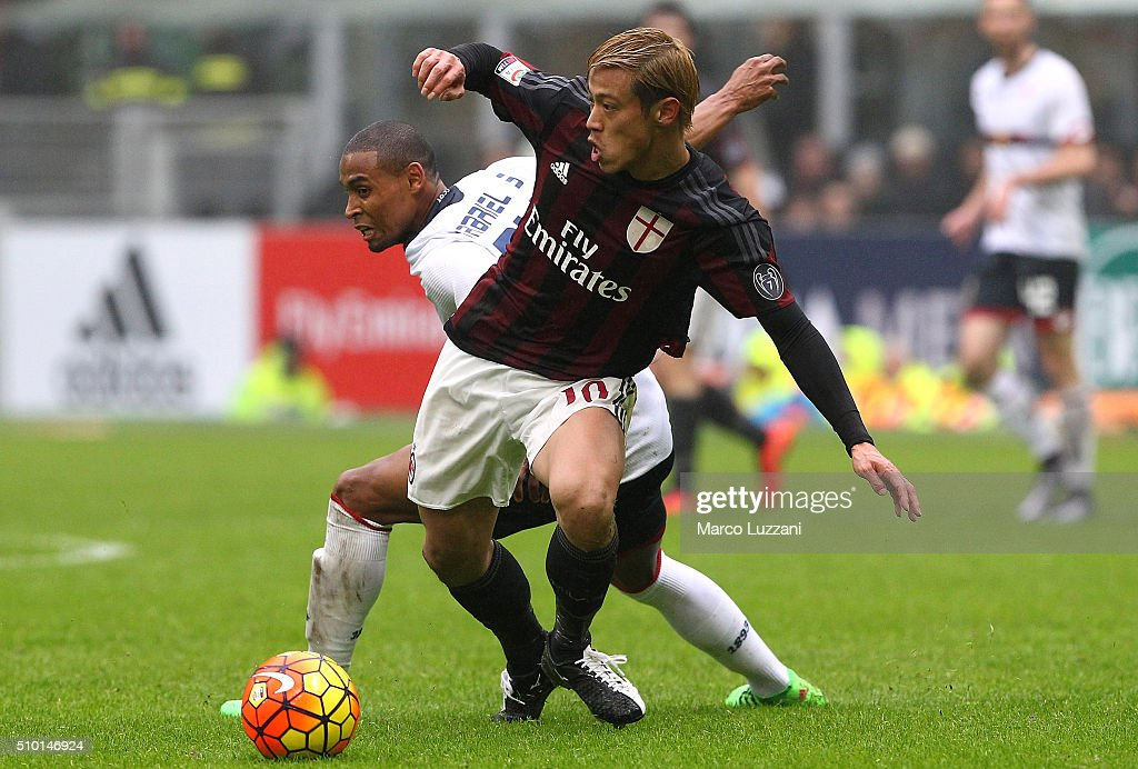 <a gi-track='captionPersonalityLinkClicked' href=/galleries/search?phrase=Keisuke+Honda&family=editorial&specificpeople=2333022 ng-click='$event.stopPropagation()'>Keisuke Honda</a> of AC Milan is challenged by <a gi-track='captionPersonalityLinkClicked' href=/galleries/search?phrase=Gabriel+Silva+-+Soccer+Player&family=editorial&specificpeople=8960584 ng-click='$event.stopPropagation()'>Gabriel Silva</a> (back) of Genoa CFC during the Serie A match between AC Milan and Genoa CFC at Stadio Giuseppe Meazza on February 14, 2016 in Milan, Italy.