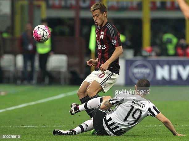 Keisuke Honda of AC Milan is challenged by Leonardo Bonucci of Juventus FC during the Serie A match between AC Milan and Juventus FC at Stadio...