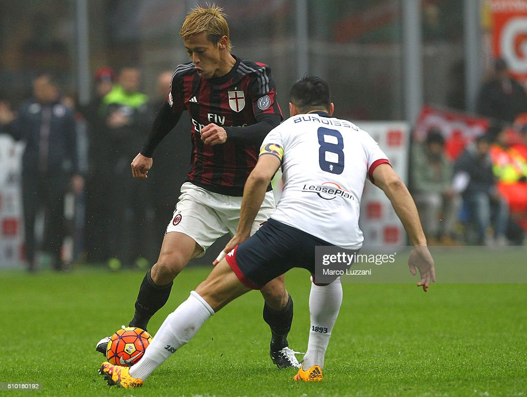 <a gi-track='captionPersonalityLinkClicked' href=/galleries/search?phrase=Keisuke+Honda&family=editorial&specificpeople=2333022 ng-click='$event.stopPropagation()'>Keisuke Honda</a> of AC Milan is challenged by Nicolas Andres Burdisso of Genoa CFC during the Serie A match between AC Milan and Genoa CFC at Stadio Giuseppe Meazza on February 14, 2016 in Milan, Italy.