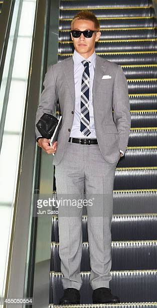 Keisuke Honda of AC Milan is seen at Haneda Airport on September 10 2014 in Tokyo Japan