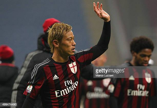 Keisuke Honda of AC Milan salutes the fans at the end of the TIM Cup match between AC Milan and FC Crotone at Stadio Giuseppe Meazza on December 1...