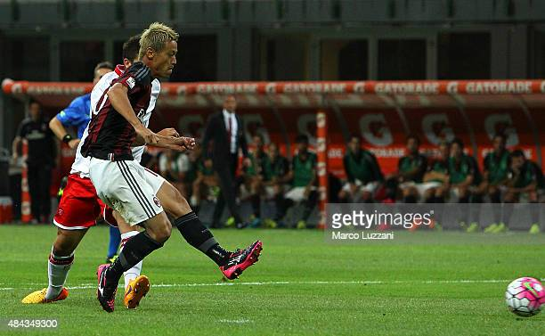 Keisuke Honda of AC Milan scores the opening goal during the TIM Cup match between AC Milan and AC Perugia at Stadio Giuseppe Meazza on August 17...