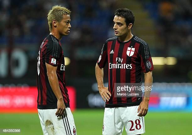 Keisuke Honda of AC Milan speaks to his teammate Giacomo Bonaventura during the TIM Cup match between AC Milan and AC Perugia at Stadio Giuseppe...