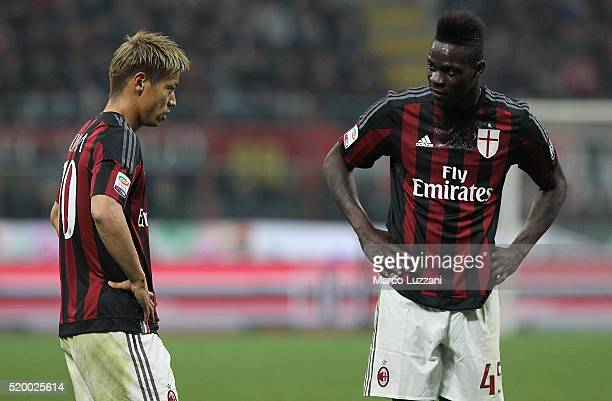 Keisuke Honda of AC Milan speaks to his teammate Mario Balotelli during the Serie A match between AC Milan and Juventus FC at Stadio Giuseppe Meazza...