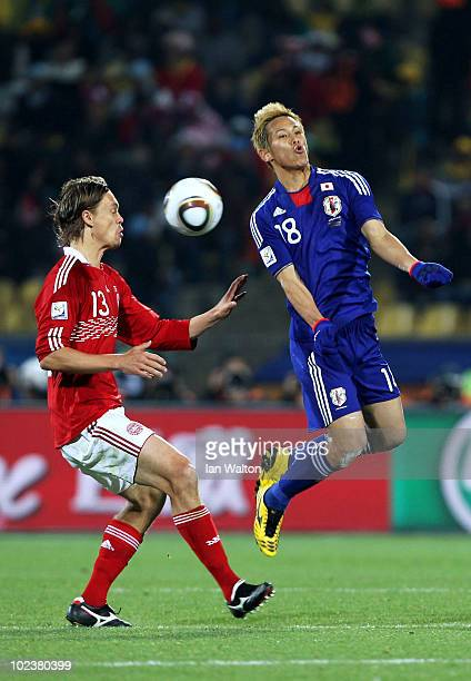 Keisuke Honda of Japan and Per Kroldrup of Denmark in action during the 2010 FIFA World Cup South Africa Group E match between Denmark and Japan at...