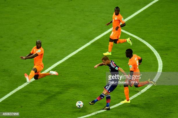 Keisuke Honda of Japan attempts a shot on goal during the 2014 FIFA World Cup Brazil Group C match between Cote D'Ivoire and Japan at Arena...