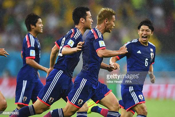 Keisuke Honda of Japan celebrates after scoring a goal during the 2014 FIFA World Cup Brazil Group C match between Cote D'Ivoire and Japan at Arena...