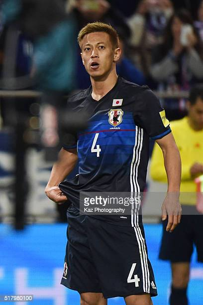 Keisuke Honda of Japan celebrates scoring his team's third goal during the FIFA World Cup Russia Asian Qualifier second round match between Japan and...