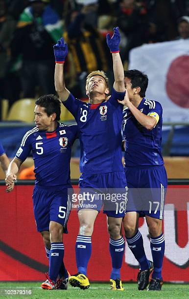 Keisuke Honda of Japan celebrates scoring the opening goal from a free kick during the 2010 FIFA World Cup South Africa Group E match between Denmark...